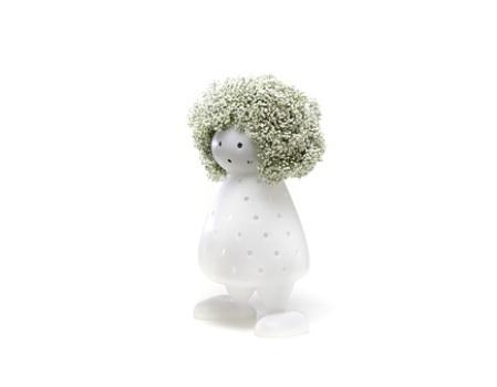 Foto de Un jarrón o... ¿un muñeco que se viste con las flores? (1/5)