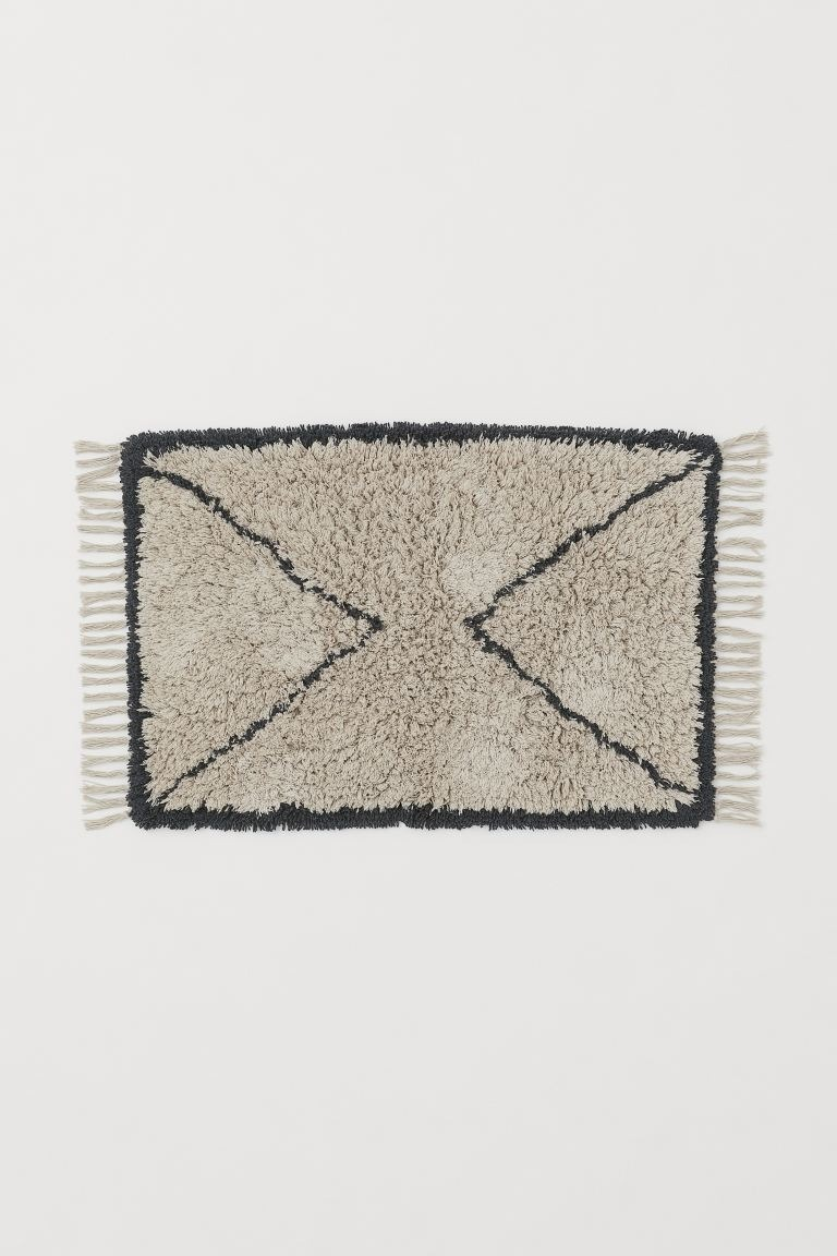 Alfombra de baño grande en algodón estampado de pelo largo con flecos en los extremos