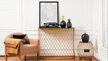 Decorar la casa con colores dorados y negros, todo un diseño de alta costura
