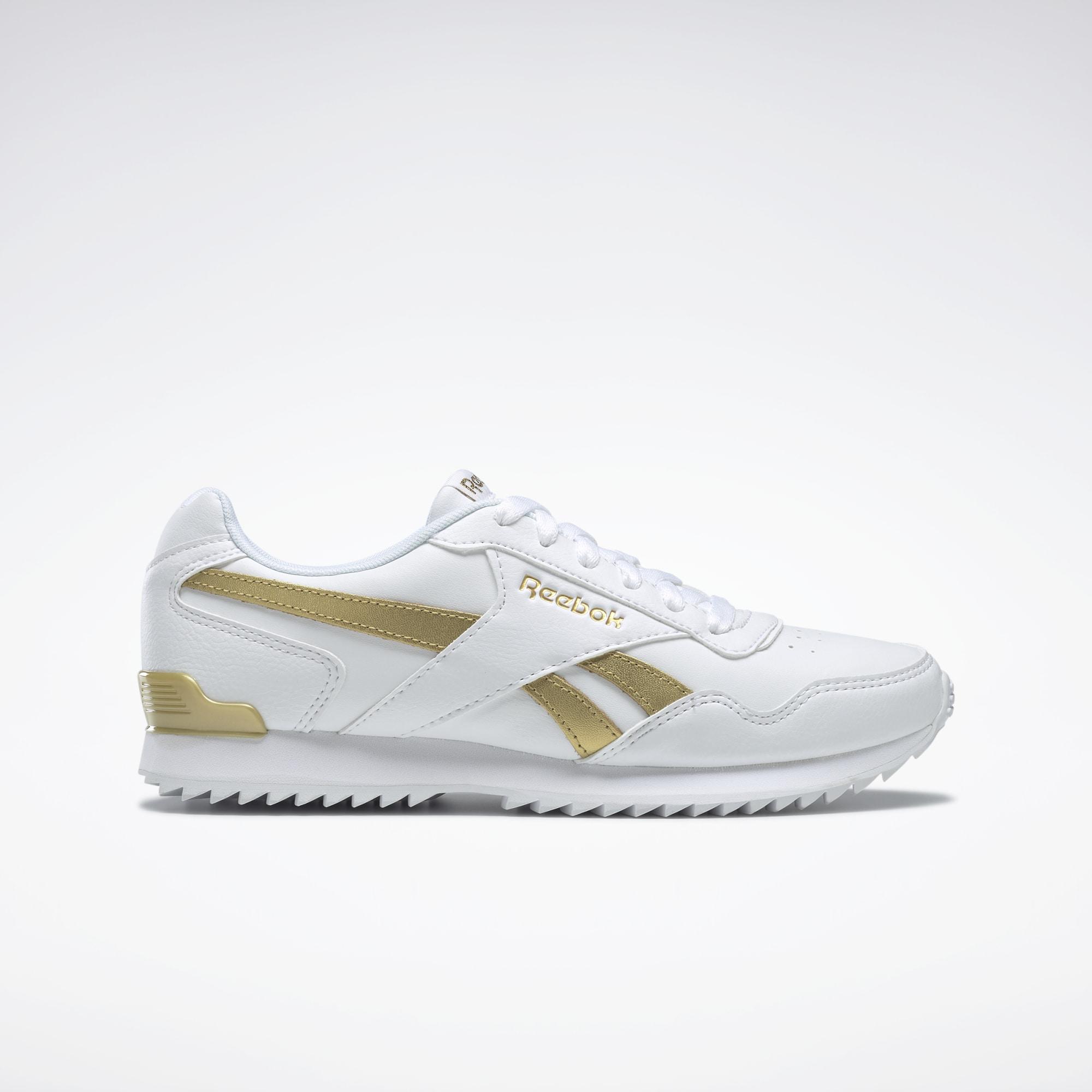 Zapatillas blancas con detalles en dorado