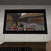 Cuando crees que Minecraft ya no puede sorprenderte más, alguien añade un PC con Windows 95 para jugar a Doom en él