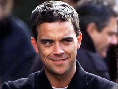 A Robbie Williams le visitan los Aliens