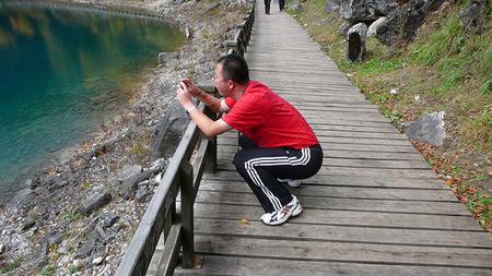 Squatting Photographer Pose, por Augapfel