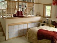 Dormitorios en varias zonas: Un dormitorio con biblioteca
