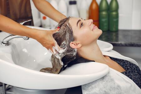 Woman Washing Head In Hairsalon