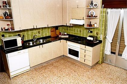 Distribuci n de la cocina cocinas en l for Cocina comedor en l