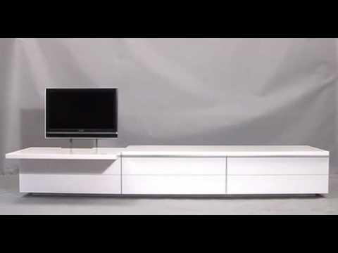 Mueble para el televisor con un mecanismo que lo oculta for Mueble que esconde la tv
