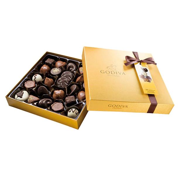 2x1 Bombones belgas Gold 24 piezas Godiva. Los chocolates más representativos de Godiva, cuidadosamente seleccionados para ofrecer una amplia gama de los mejores rellenos para todos los gustos. 24 piezas sin alcohol.