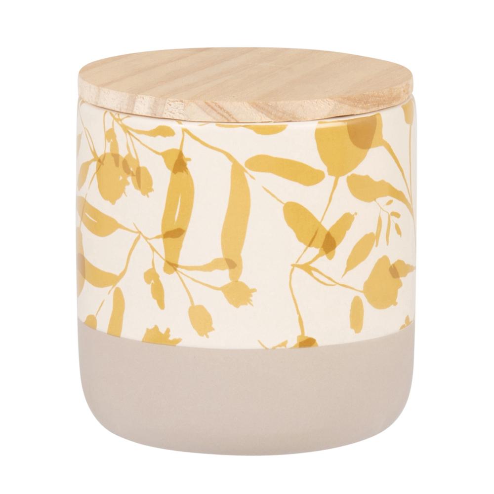 Vela perfumada en tarro de cerámica beige con motivos color mostaza