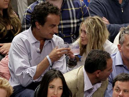 Mon Dieu! Mary-Kate Olsen sale con un Sarkozy