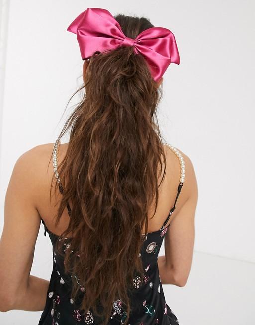 Pasador para el pelo rosa con lazo de satén de ASOS DESIGN
