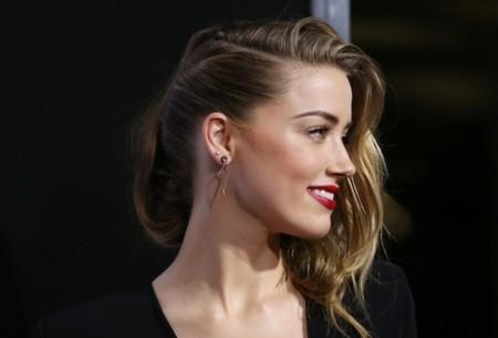 Amber Heard, la chica que tiene el mejor complemento para las alfombras rojas: Johnny Depp