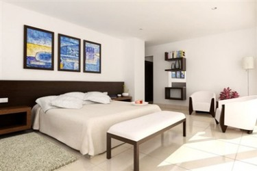 Dormitorios en varias zonas: Un dormitorio con zona de descanso (IV) e imágenes