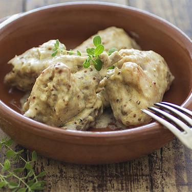 Conejo guisado con mostaza  a la antigua: receta de diario con un plus de sabor
