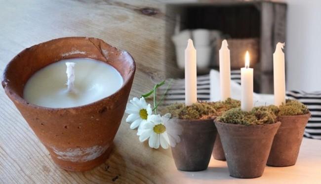 Tiestos de barro con velas