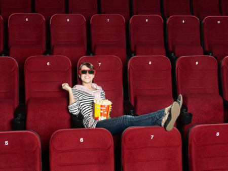 Woman Alone In Movie Theater 500x375c