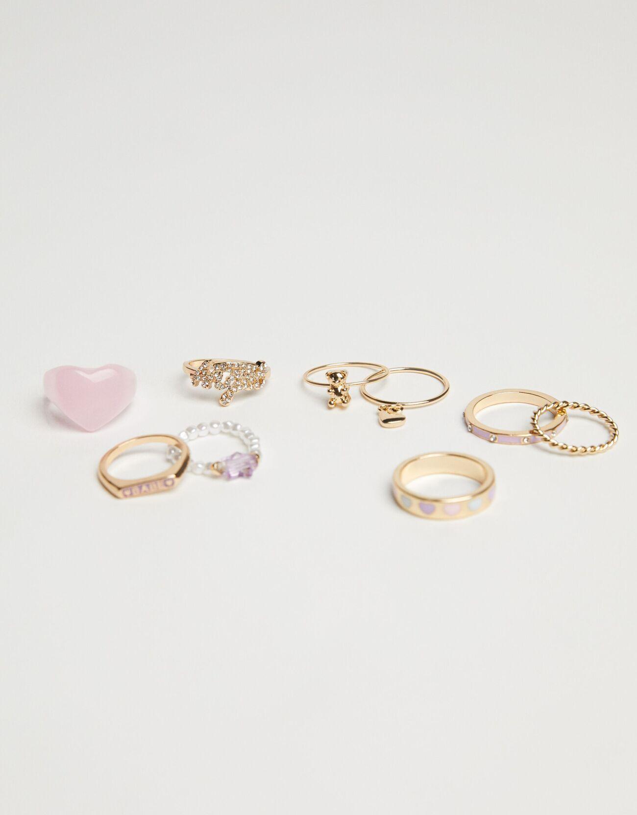 Pack de nueve anillos con detalles rosa pastel dosmileros
