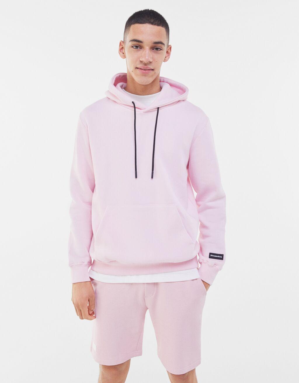 Sudadera con capucha en color rosa millenial