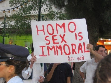 Protestors At A Pride Parade In Jerusalem With Sign That Reads Homo Sex Is Immoral Lev 18 22