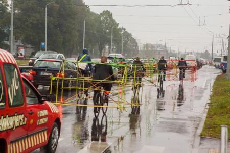 Cyclists Wear Car Frame Latvia Riga Designboom 13