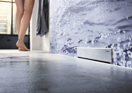 Minimalista y accesible, la ducha lisa y continua se impone en el cuarto de baño