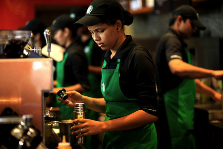 Employees Work Inside The Starbucks At The Taj Mahal Palace Hotel In South Mumbai India