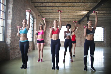 Women S Assorted Sports Bras Raising Their Pink Dumbbells 864990