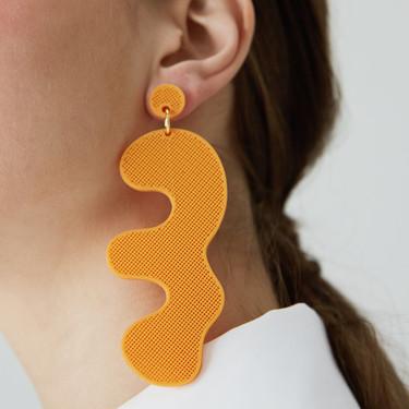11 pendientes naranjas para dar un plus de vitalidad a tus looks de invierno