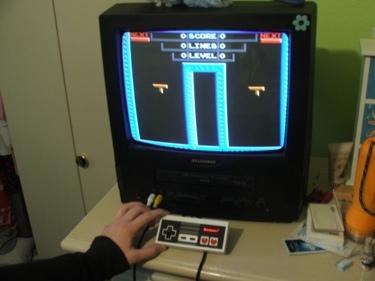 Una NES metida en el mando