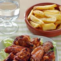 Alitas de pollo al horno con salsa harissa. Receta