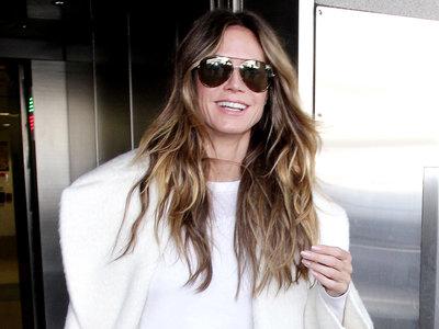 Rompemos una lanza a favor del abrigo blanco: este es el look de Heidi Klum que todos podemos copiar
