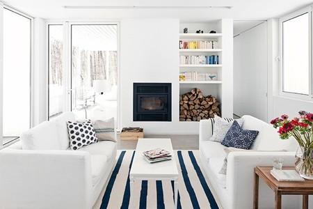 Puertas abiertas: color blanco y estilo escandinavo contrastado con madera y detalles de color