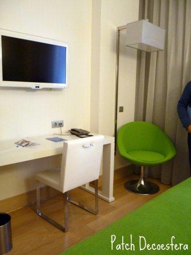 Habitación verde de los hoteles NH después de la reforma.