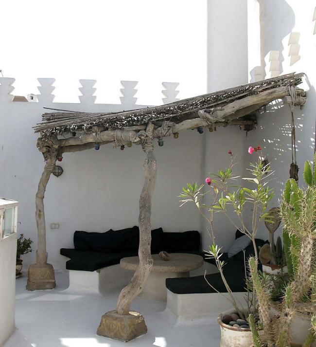 Cinco hermosas soluciones para proteger tu terraza del sol for Donde venden cortinas baratas