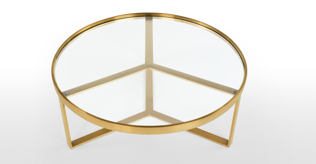 Mesa baja de centro de cristal y latón