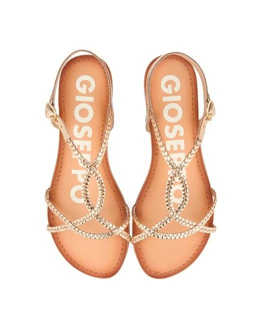 Sandalias planas de piel en color oro