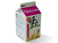 Leche materna en cartón de leche