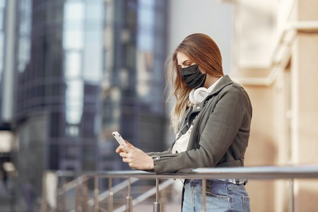 Woman In Gray Coat Holding Smartphone 3985184