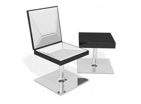 Una mesa negra y una silla blanca