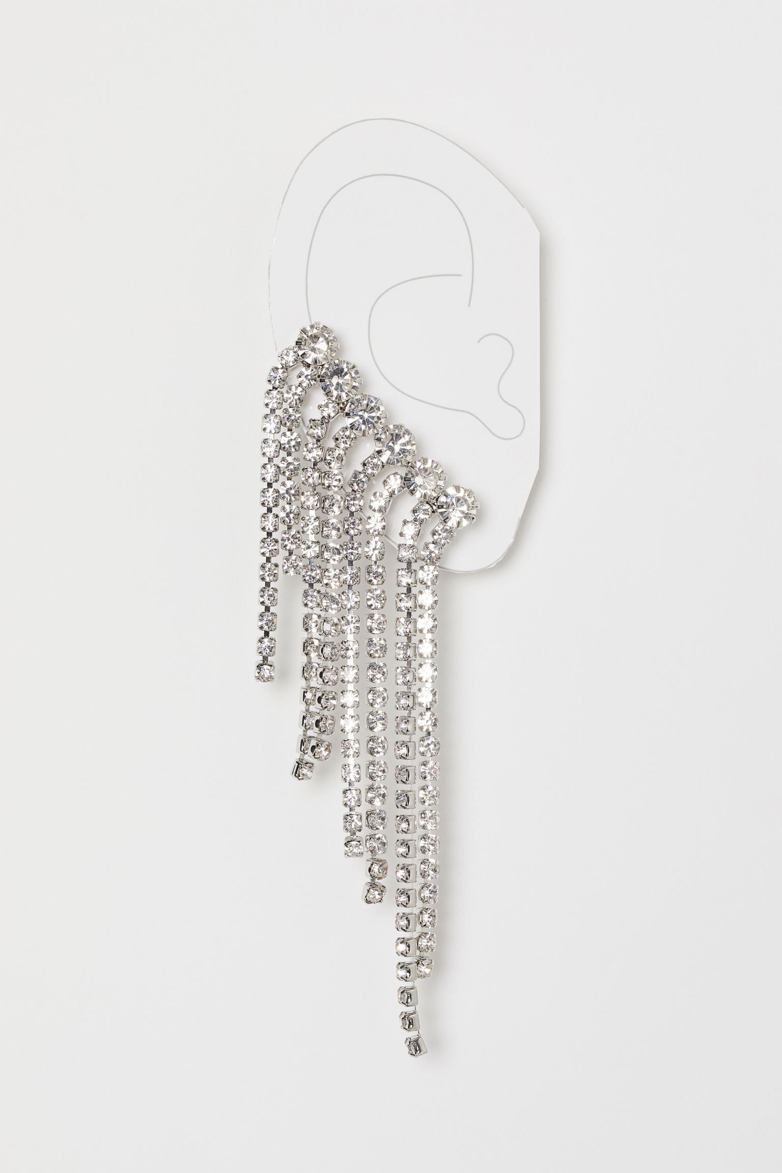 Adorno para oreja en metal con strass de vidrio. Ear cuff en la parte superior y perno abajo.
