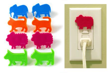 Cubre la toma de corriente con animalitos