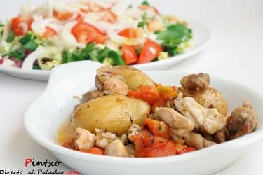 Receta de muslos de pollo guisados con patatas y tomates