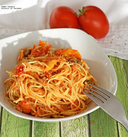 Espagueti con jitomates cherry salteados, limón y atún. Receta sencilla y rápida