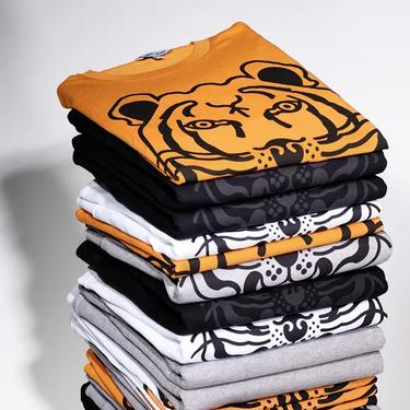 Kenzo rediseña su icónico tigre por una buena causa: así son las camisetas y sudaderas que podrían salvar a muchos de estos felinos