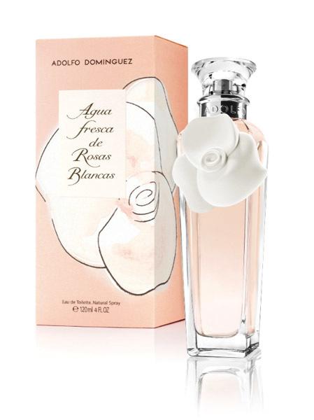 Bodegon frasco agua de rosas blancas