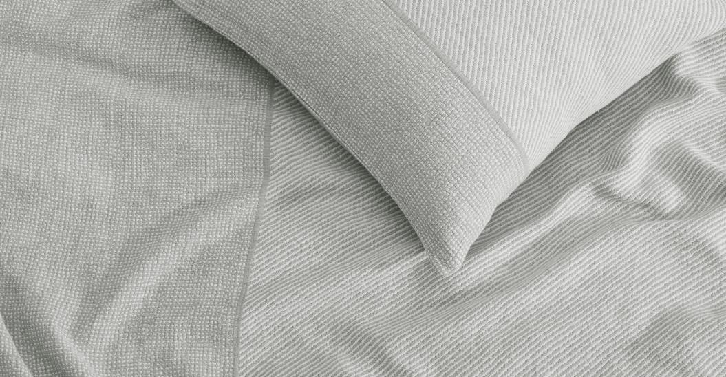 Manta 100% de algodón orgánico Enya, gris cálido.