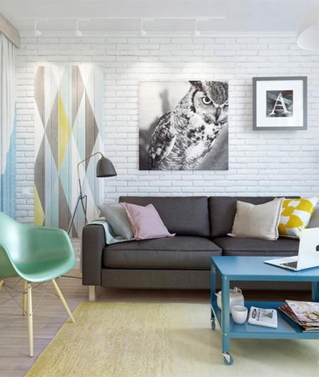 Salón con pared de ladrillo blanco