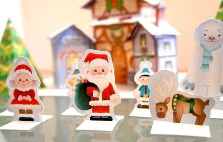Añade unos cuantos personajes a la casa de Papá Noel para imprimir y montar