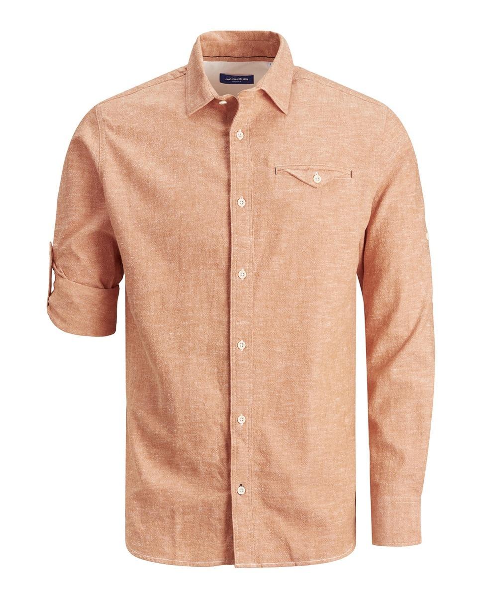 Camisa con algodón BCI slim fit de color marrón lisa. Tiene cuello clásico y puños redondeados.