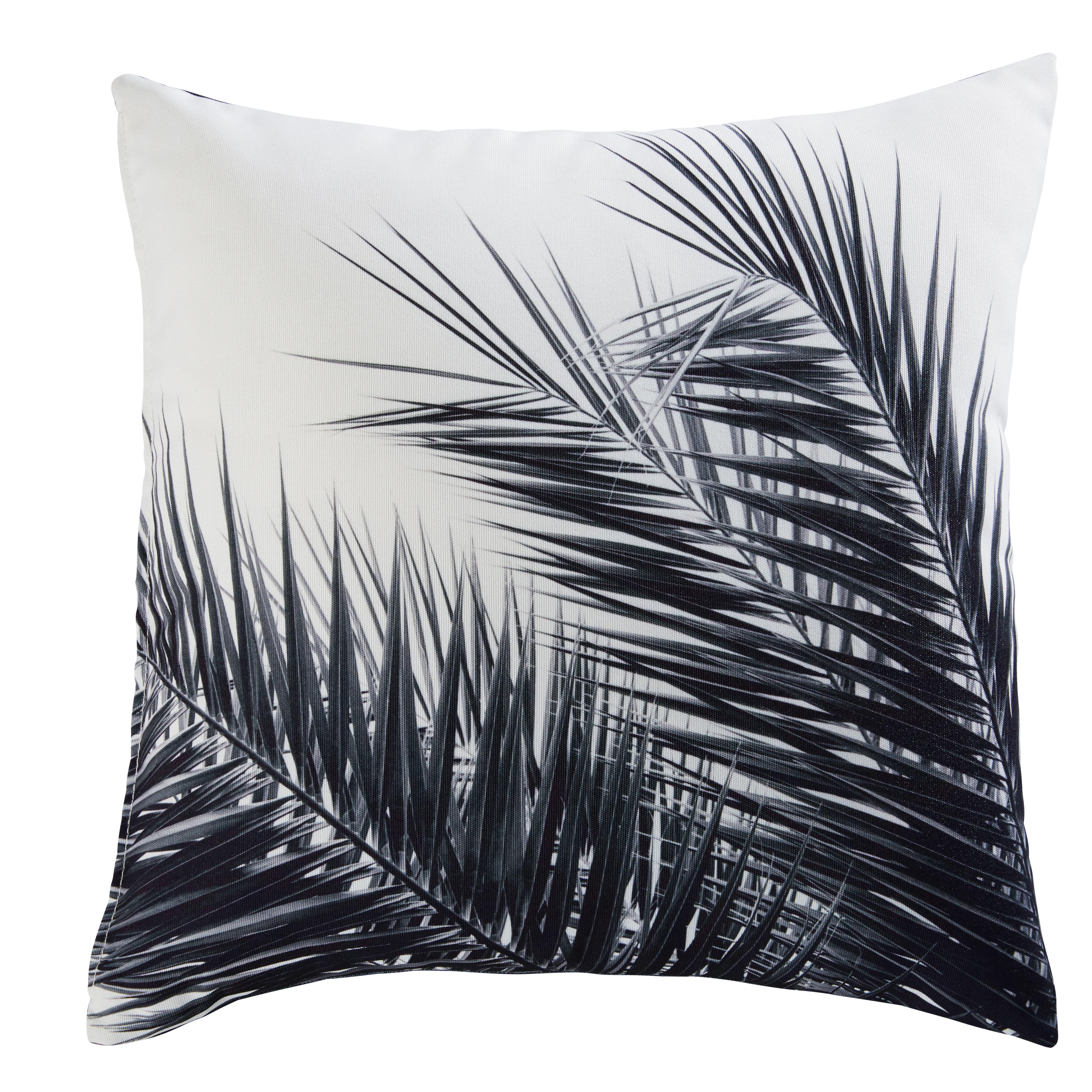 Cojín de tela blanca y negra con estampado de palmera 45x45